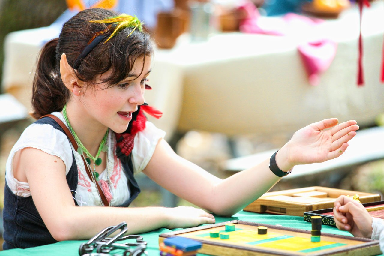 Girl playing medieval board games